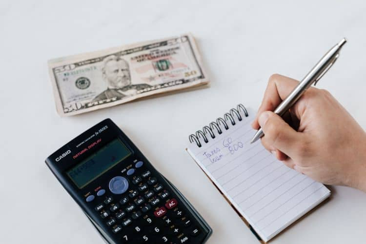 financial goal setting with pen and notepad